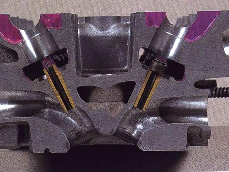 A side-by-side comparison of Toyota's 4AG heads and Honda's F20C - in pictures.