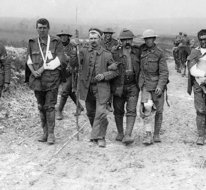 A German soldier escorting British prisoners along the Menin Road.