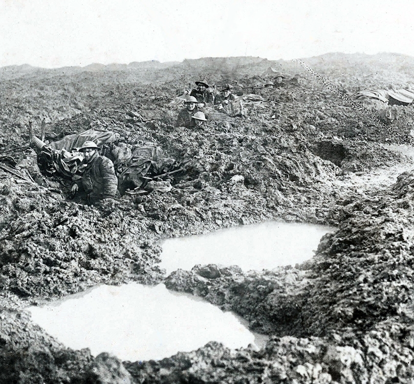 Soldiers from the Canadian 16th Machine Gun Company holding the line in miserable conditions on the Passchendaele front. Corporal Ronald Lebrun, the machine gunner on the left, was the only survivor from this photograph.