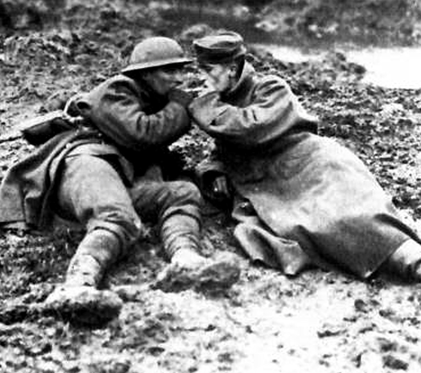 A Canadian soldier lighting the cigarette of a German prisoner at Passchendaele on the Western Front.