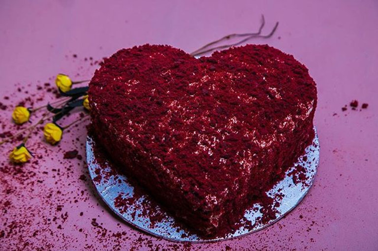 A hart Shaped Red Velvet Cake with cream cheese frosting