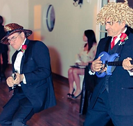 Wedding Reception Dads rock out on toy guitars provided by DJ 'RocNRev' Michael Taylor San Luis Obispo wedding officiant, DJ and emcee