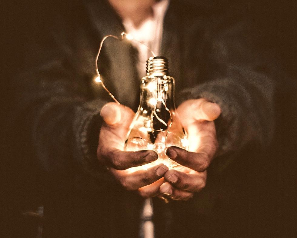 man holding incandescent bulb_edited_edited.jpg
