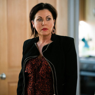 Kat tries to stop Phil from doing a runner with Raymond in EastEnders