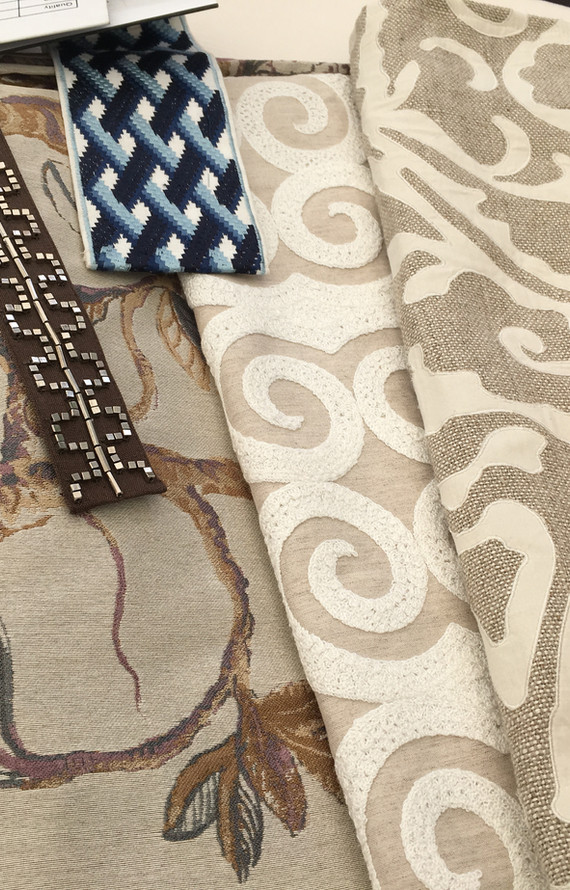 A variety of embroidered fabrics and tapes