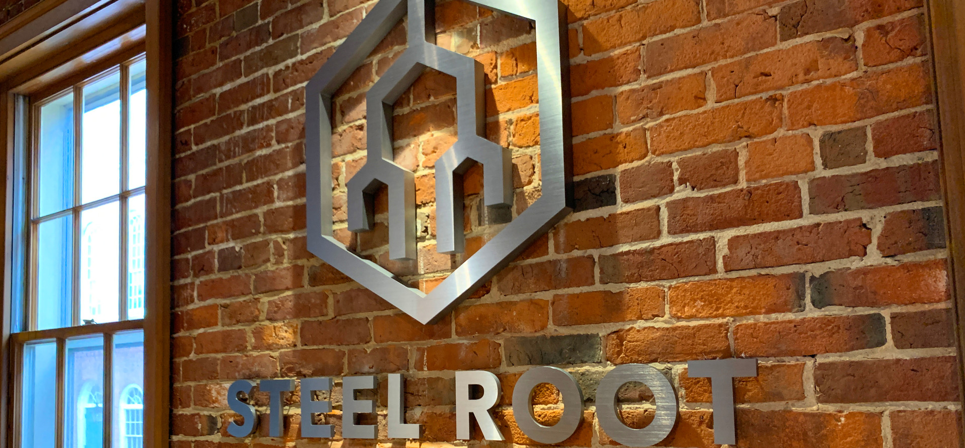 Steel Root Logo on Brick
