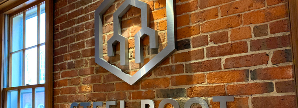 Steel Root Logo on Brick