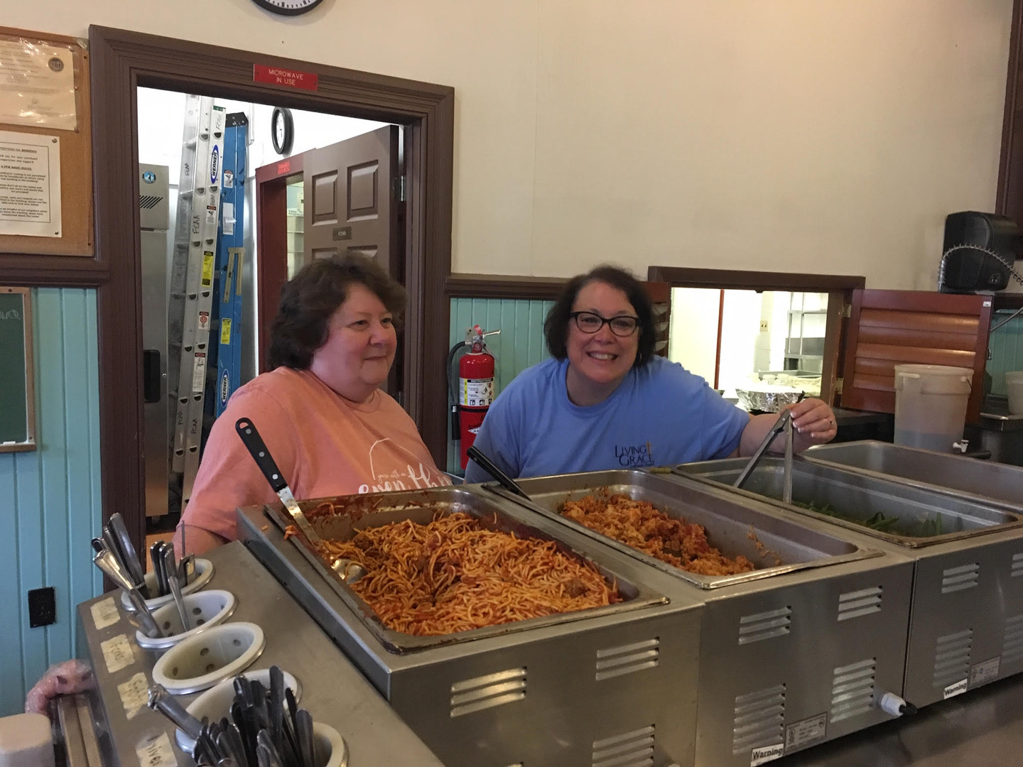 Phyllis and Carol Man the Spaghetti.jpg