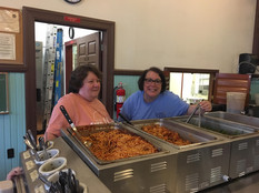 Phyllis and Carol Man the Spaghetti.jpg