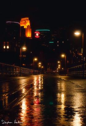 rain on stone arch bridge