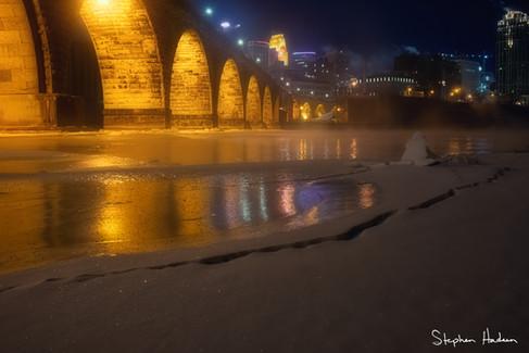 river smoke at stone arch bridge