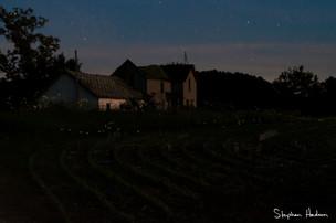 fireflies and farmhouse