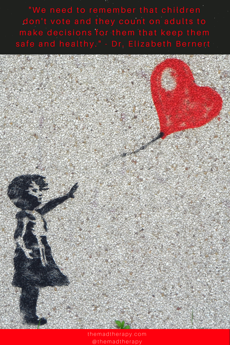 little girl reaching for heart symbolizing the separation of migrant children from their parents at the border