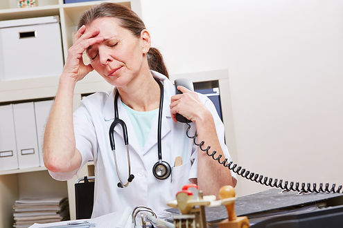 Doctor with burnout snydrome in office a