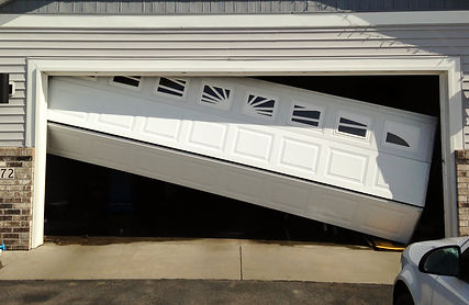 Repair Broken Garage Door Hanging Off Track in Opening
