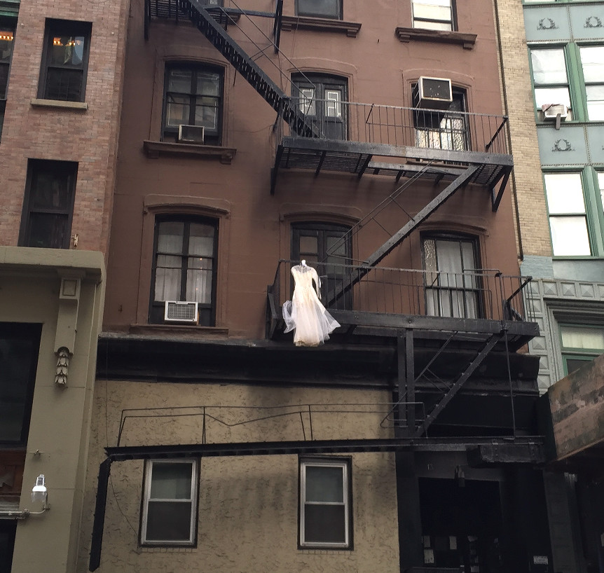wedding dress on fire escape in NYC, March 2016