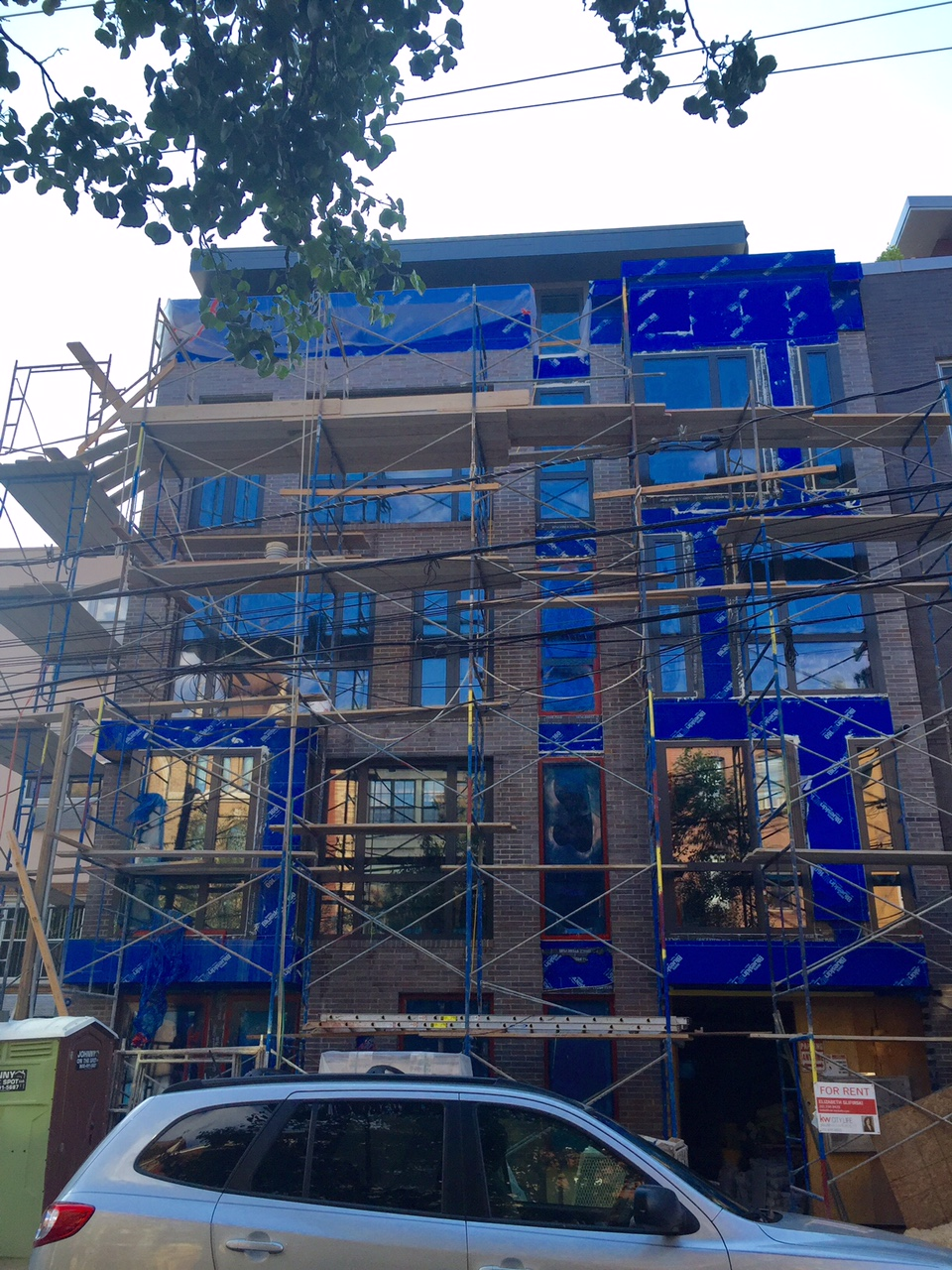 6/9/15 Facade almost all bricked up.