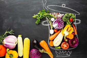 flat-lay-colorful-veggies-chalk-pot_23-2