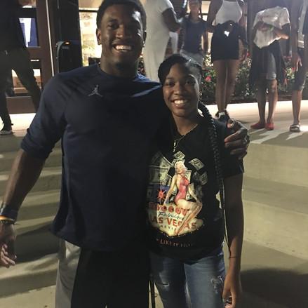 University of Michigan football player and Sarasota Native Karon Higdon welcoming 9th Grade Shmyra Wheeler to the campus.