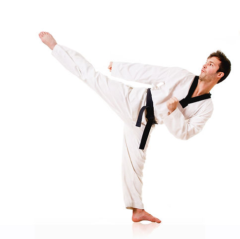 Young man practicing martial arts over w