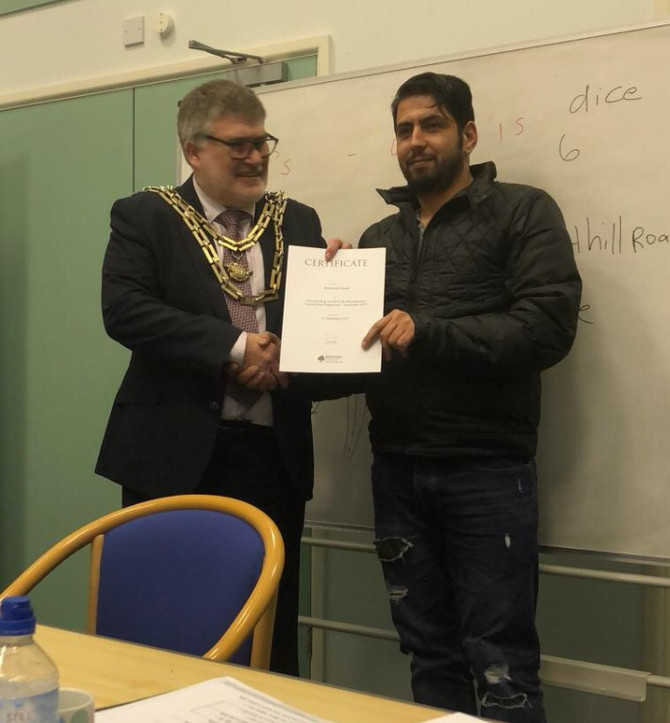Mohamad Khater receiving his ESOL certificate from the Mayor