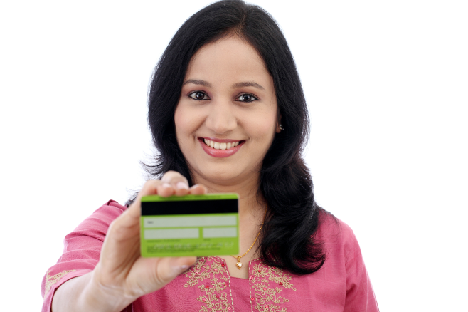A smiling woman holds up the back of a secured credit card.