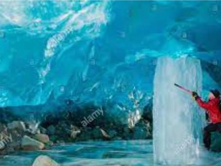 How do ice columns grow inside caves?