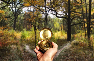 Holding a compass in Ohiopyle State Park