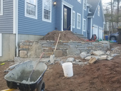 working on stone wall