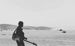 Guitarist on the beach