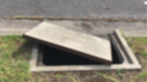 damaged telstra pit