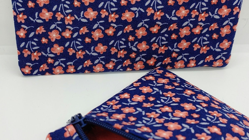 Coral flowers on a navy background pouch