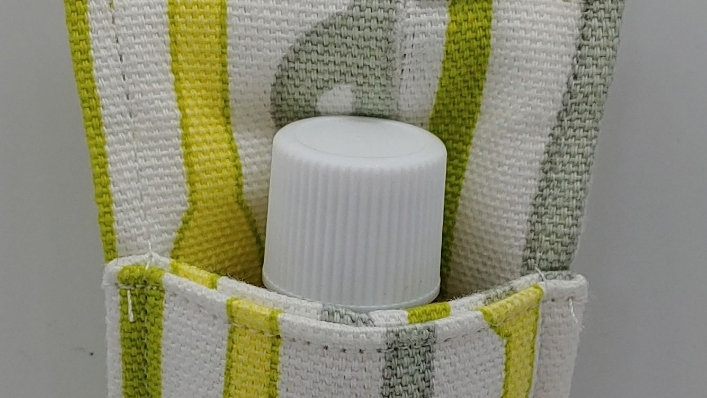Yellow and gray hand sanitizer holder