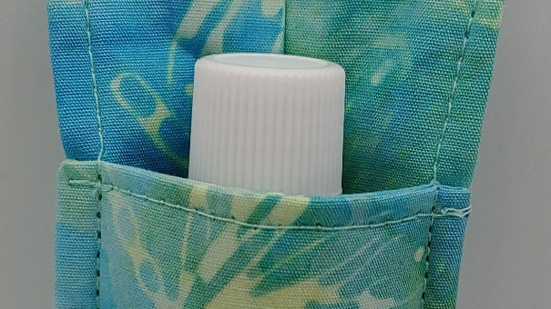 Shaded green dragonfly hand sanitizer holder