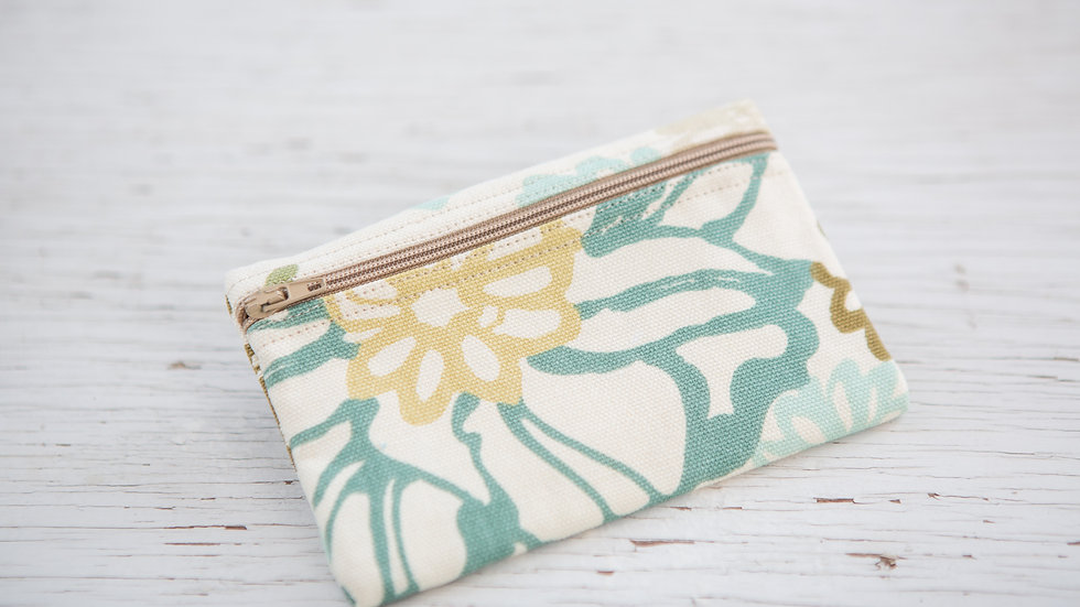 Floral print of muted shades of gold and teal EO Pou