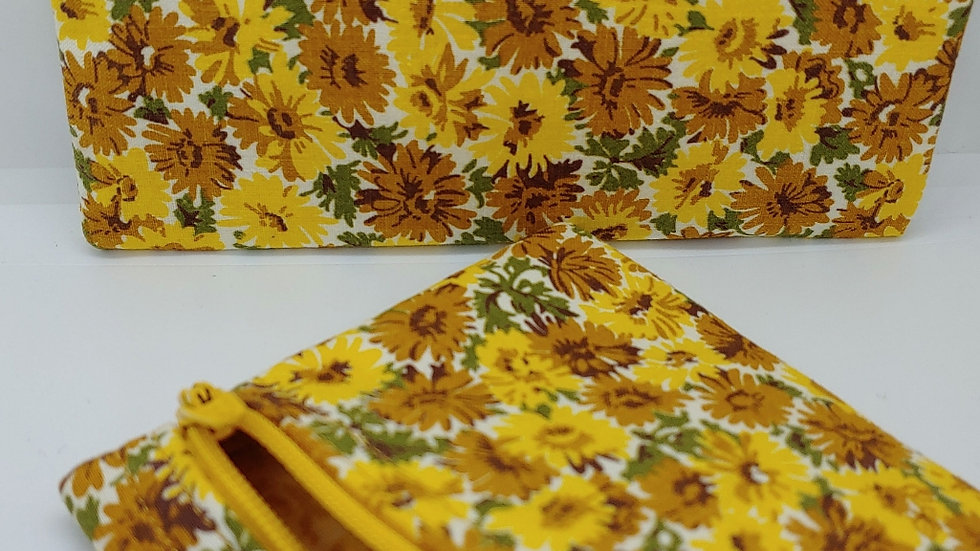 Yellow and brown flowered pouch