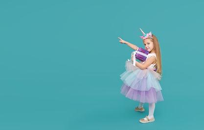 Cute child girl in elegant tulle dress a