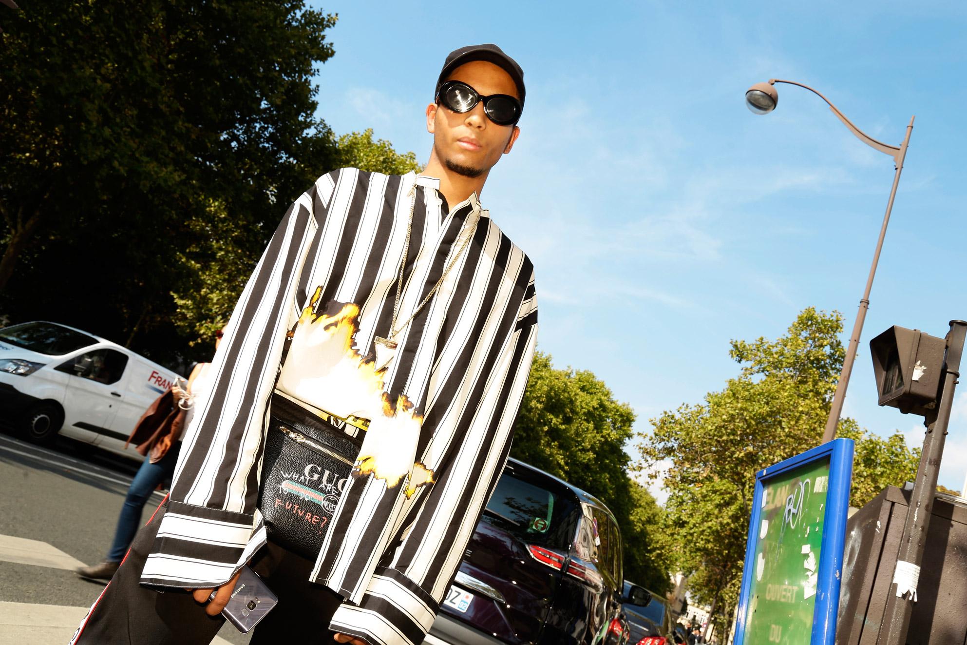 Travis Guigne Wearing Gucci bag & Haider Ackermann shirt