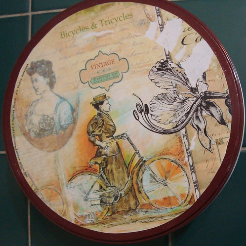 """Two round tin boxes - """"Tricycles & bicycles"""""""