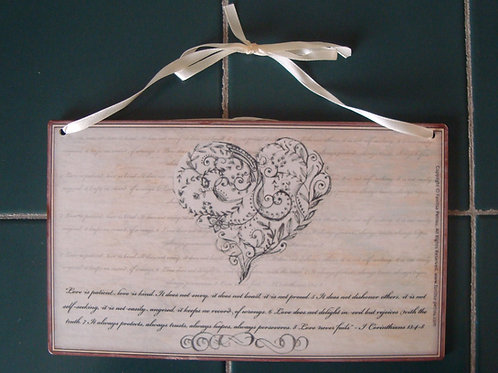 """Love is patient"" wooden sign"