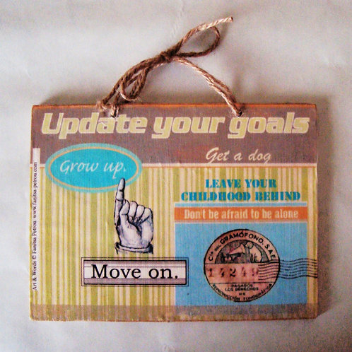 """Update your goals"", wooden sign"