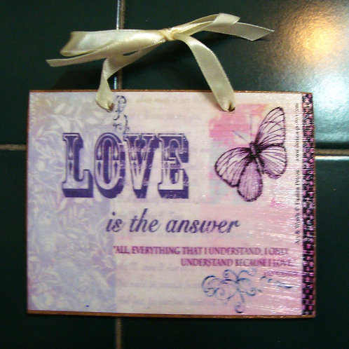 """Love is the answer"" small wooden sign"