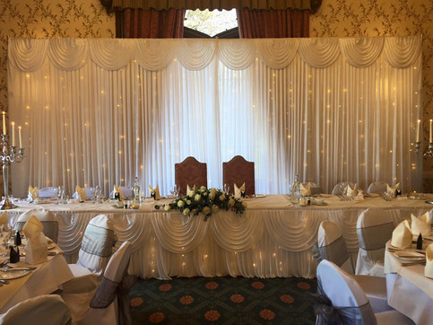 Starlight backdrop and starlight top table skirt