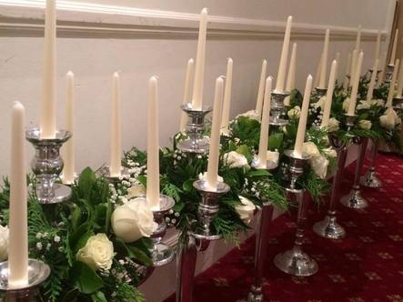 Candelabras with fresh flower arrangment