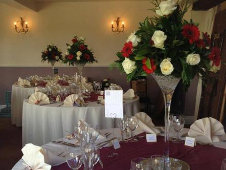Martini vases with fresh flower arrangement