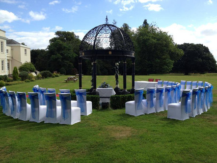 White strech covers with royal blue organza sashes