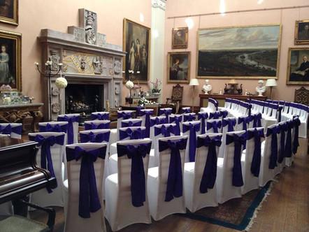 White streth covers and purple crinkle taffeta sashes