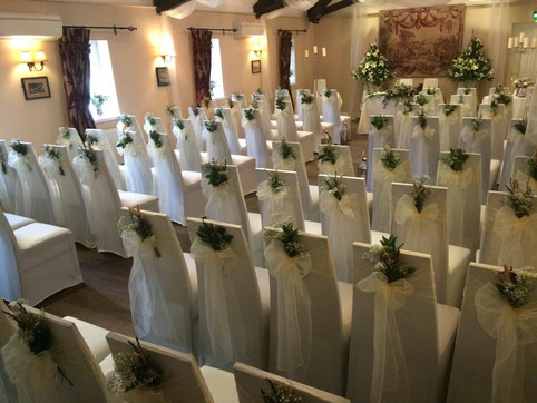 Ivory stretch covers and ivory organza sashes