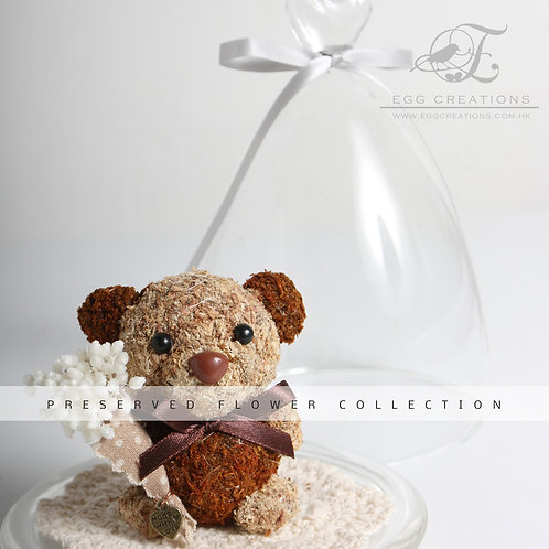 Bear with flower bouquet in glass jar
