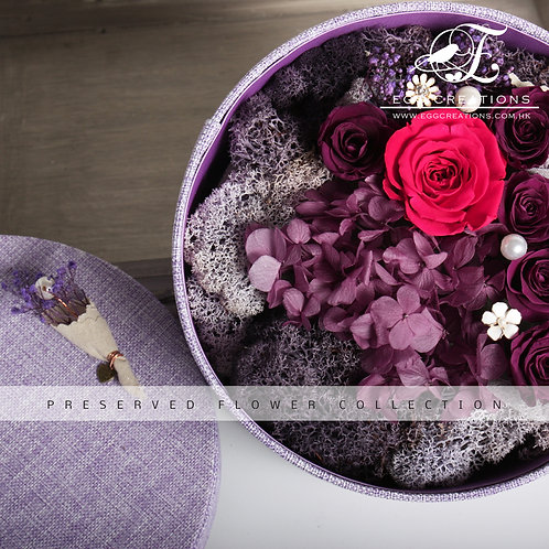 Preserved flowers in round cotton-wrapped box
